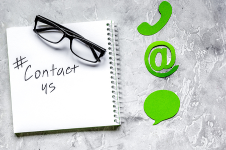 e-mail contact us concept with internet icons on work desk backg
