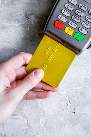 purchase with payment terminal by card on stone background top v