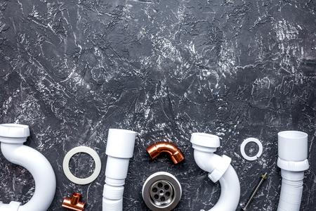 concept plumbing work top view on dark background