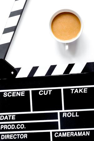 Screenwriter desktop with movie clapper board on white background top view Stok Fotoğraf