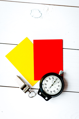 red and yellow cards on wooden background top view