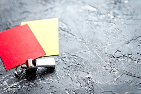 red and yellow cards on dark background close up Imagens