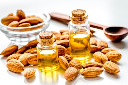 organic cosmetic set with almond extract in bottle on light table background