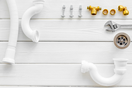 Professional instruments for plumber on white wooden background top view space for text Reklamní fotografie