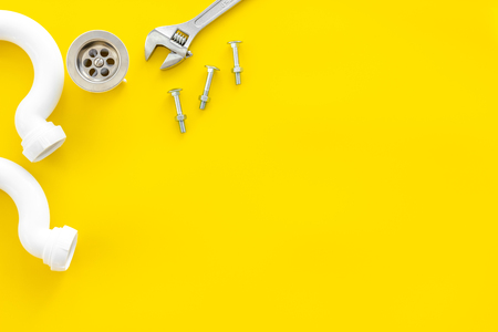 Plumber profession with gear and instruments for repair tubes on yellow background top view copyspace Reklamní fotografie