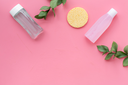 Organic cosmetics for face clearing with sponge, facial tonic and mycelial water on pink background top view copy space Фото со стока