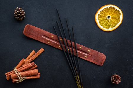 citrus and cinnamon fragrance diffuser for air freshness on dark background top view Stock Photo