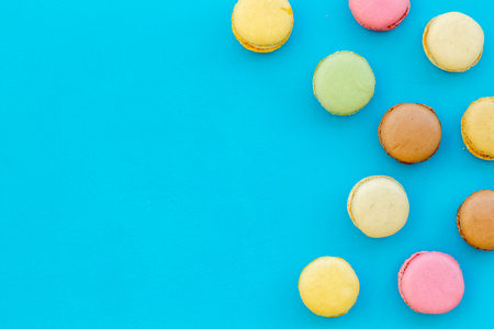 sweet dessert pattern with macarons on blue background flat lay mockup