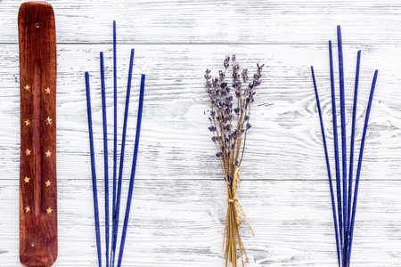 air freshener sticks with lavender on white wooden background top view