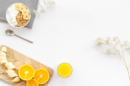 Healthy granola and orange juice for colorful breakfast on white background top view mock-up