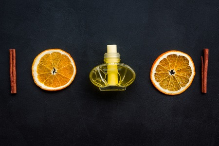 air freshener sticks with cinnamon and orange on dark background top view mockup