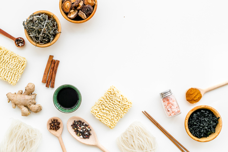 Geometric design with Chinese, Japanese products, noodles, weeds, spices, mushrooms on white background top view mockup