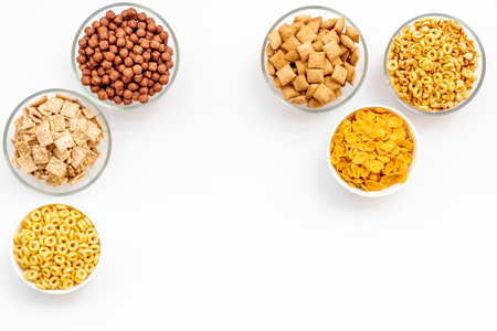 Cereals and flakes from corn and oat on white background top view mockup