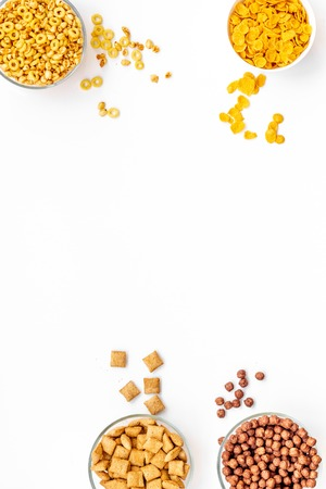 Various corn cereals in bowls on white background top view copyspace 版權商用圖片