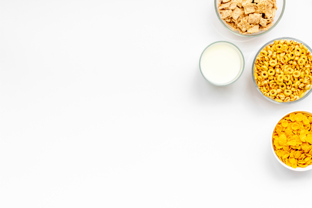Various cereals in bowls and milk on white background top view copyspace 版權商用圖片