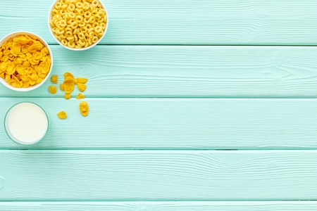 Cereals and flakes from corn and oat on mint wooden background top view mockup