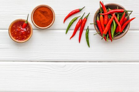 Cooking hot food with chilli pepper on white wooden table  top view copy space