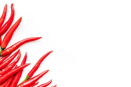 Fresh red chilli pepper as food ingredient on white table   top view mockup