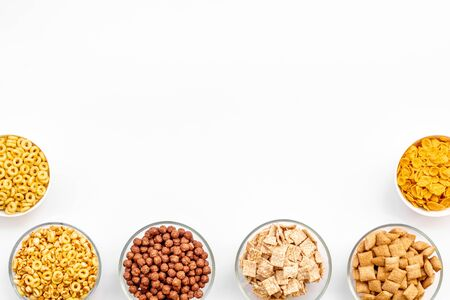Various cereals in bowls on white  top view copyspace Imagens