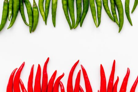 Fresh red and green chilli pepper pattern on white table  top view mockup Imagens