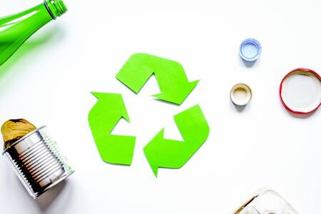 Recycling symbol with waste on white table  top view mock up Imagens