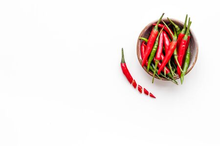 Gastronomy, culinary. Cooking hot food with chilli pepper on white table