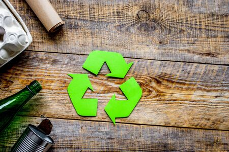 Waste and recycling symbol in eco care concept on rustic table