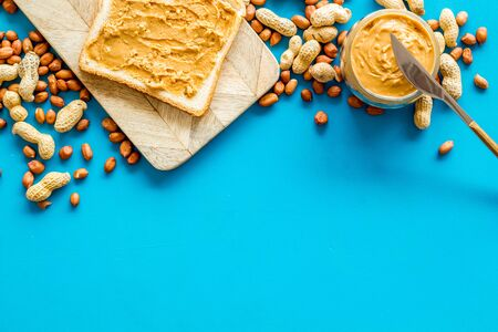 sandwiches with peanut butter for breakfast on blue background top view space for text