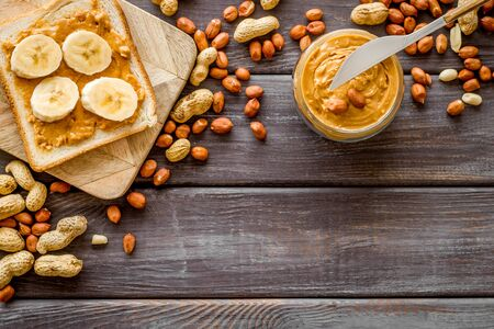 sandwiches with peanut butter and banana for breakfast on wooden background top view space for text