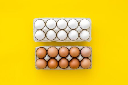 Farm products design for blog with eggs on yellow background top view