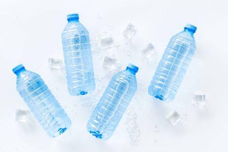 Pure frozen water in plastic bottles on white background top view Zdjęcie Seryjne