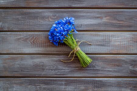 Bouquet of blue cornflowers on wooden background top view mockup