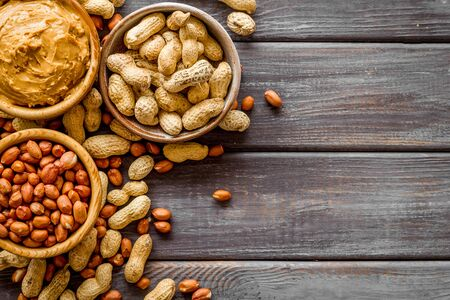 nuts in bowl for peanut butter for cooking breakfast at home on wooden background top view mock-up 写真素材