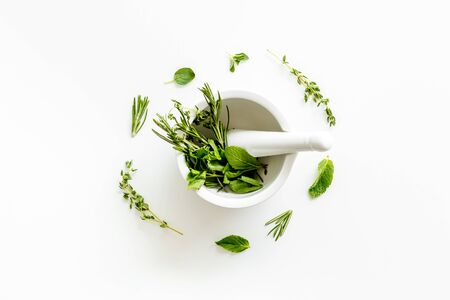 Alternative medicine with medicinal herbs on white background top view Stock Photo