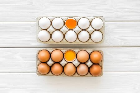 Farm products design for blog with eggs on white wooden background top view