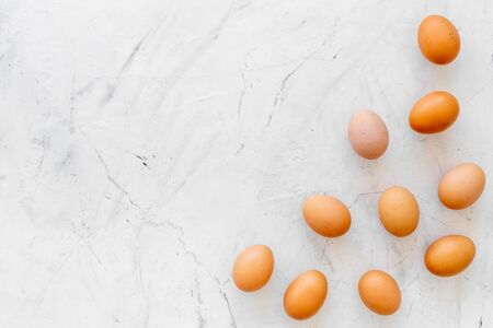 Fresh eggs for organic food on marble background top view mockup