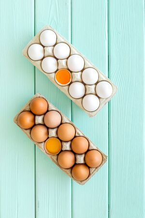 Farm products design for blog with eggs on mint green wooden background top view 版權商用圖片