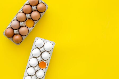 Farm products with eggs on yellow background top view mock up