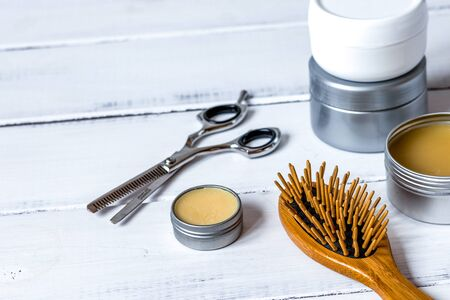 Mens cosmetics for hair care on wooden background