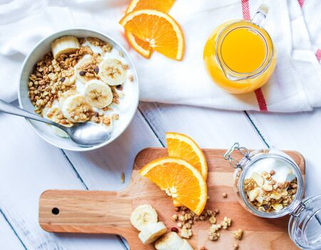 breakfast on wooden table with granola top view