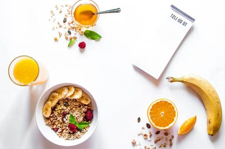 Breakfast with oatmeal and to do list on white background