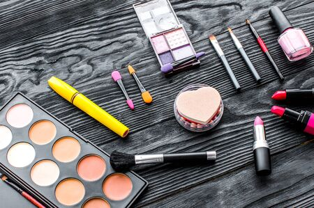 set of decorative cosmetics on wooden background top view