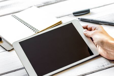 Work at desktop with electronic tablet