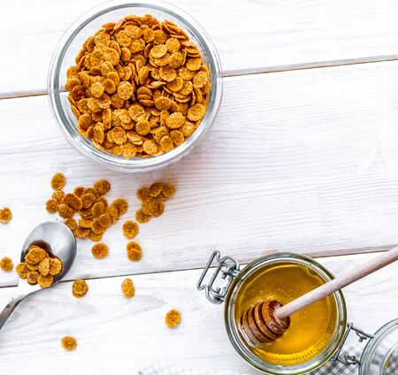 flakes for breakfast with honey on wooden bacgkround top view Imagens