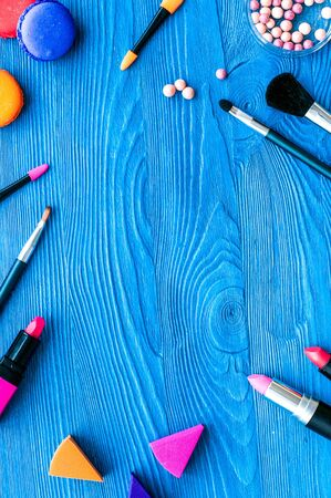 decorative cosmetics on wooden background top view