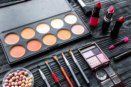 set of decorative cosmetics on wooden dark background