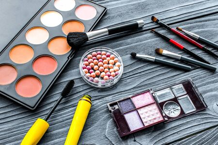 set of decorative cosmetics on wooden background Imagens