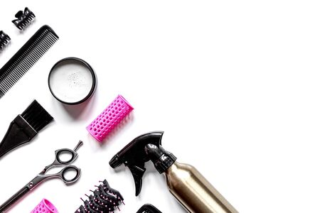 preparations for styling hair on white background top view Imagens