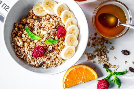 Breakfast with oatmeal and orange juice on white background