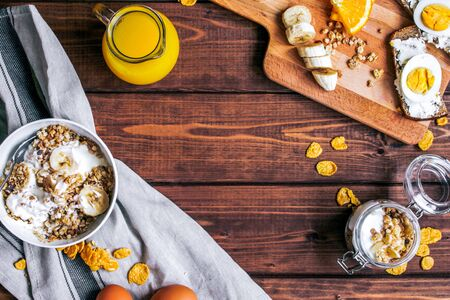 healthy breakfast bowl of yogurt with granola and eggs